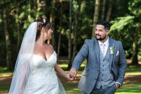 Hampton Manor Wedding Photographer Solihull, bride & groom holding hands looking at each other, romantic portrait photograph