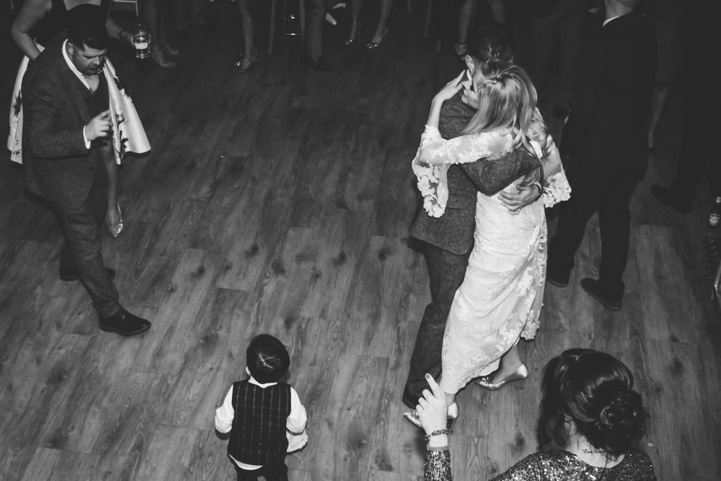 Wedding Photographer Warwickshire, bride & groom dancing, balck & white image taken from above at Wootton Park in Henley in Arden
