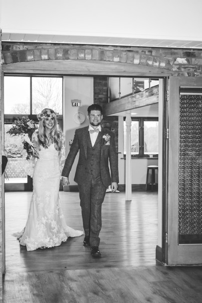 Solihull wedding photographer, the bride & groom entering the room for the wedding breakfast at wootton park Warwickshire