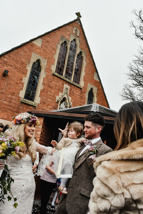 Solihull wedding Photographer, bride, groom & the flower girl just after they got married