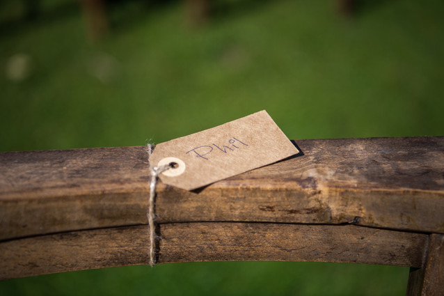 Photographer Wedding Birmingham, name tag on a rustic wedding chair at the lord leycester Warwick wedding venue
