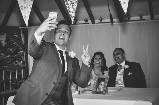 The Limes Solihull Wedding Photographer, Wedding Photographer Birmingham , a wedding guest photo bombing a photograph of the bride & groom