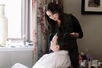 Wedding Photographer Solihull, the bridemaid having her make up done at the Westmead hotel Birmingham