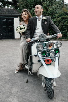 The Limes Wedding Photographer Solihull, Wedding Photographer Birmingham, informal photograph of the bride & groom sitting on their scooter laughing, fun wedding photograph