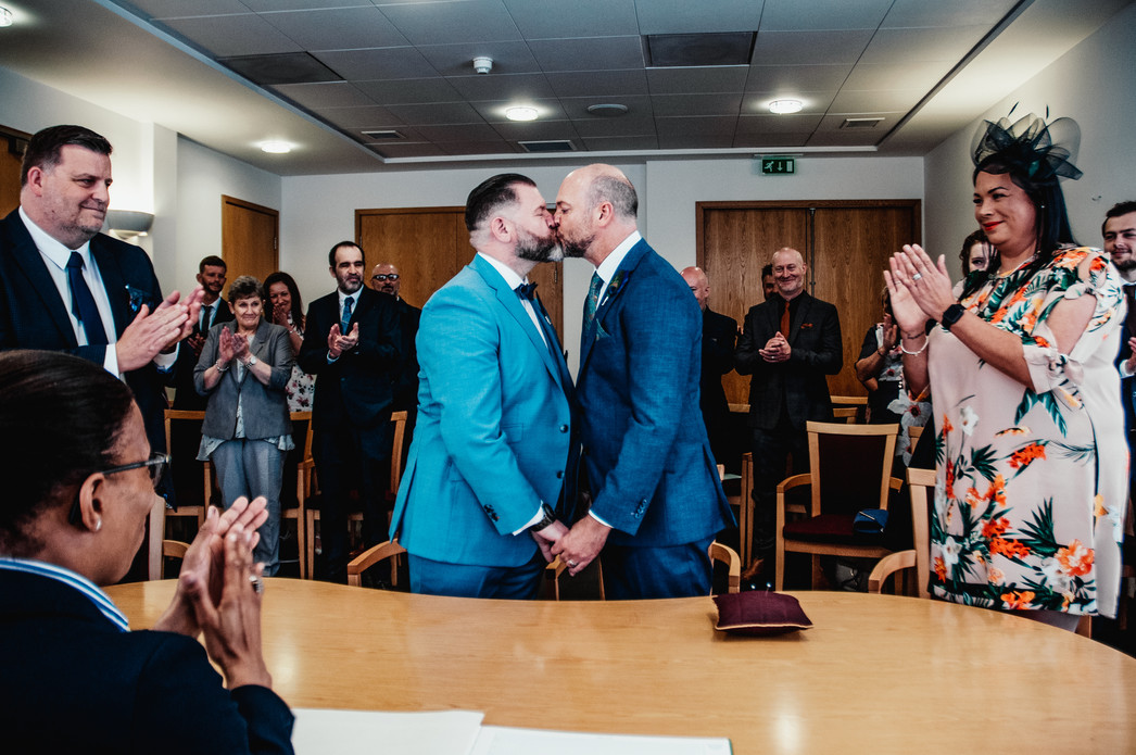 Birmingham Register Office Wedding Photographer, civil wedding Birmingham, the grooms taking their first kiss after the ceremony
