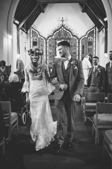 Wedding Photographer Birmingham, the bride & groom walking back down the aisle as a new married couple