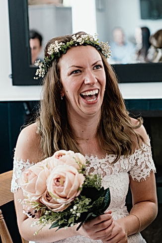 Wedding Photographer birmingham, fun wedding photograph of the bride laughing