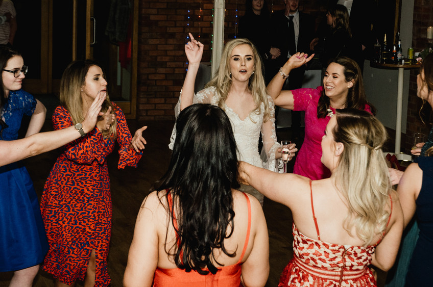 Wedding Photographer Birmingham for non traditional couples, wedding guests laughing & dancing, the bride dancing with guests at Wootton Park Henley in Arden