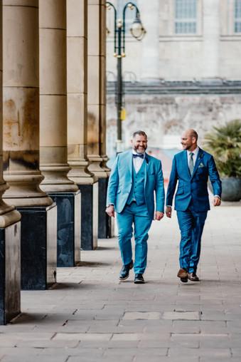 Civil Wedding Wedding Photographer Birmingham, the grooms walking, chatting towards the camera
