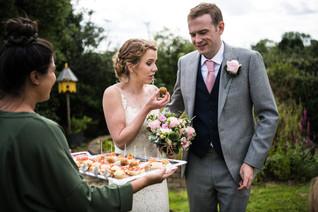 Photography wedding Birmingham, bride & groom eating canapés at the wedding breakfast at the elephant & castle rowington