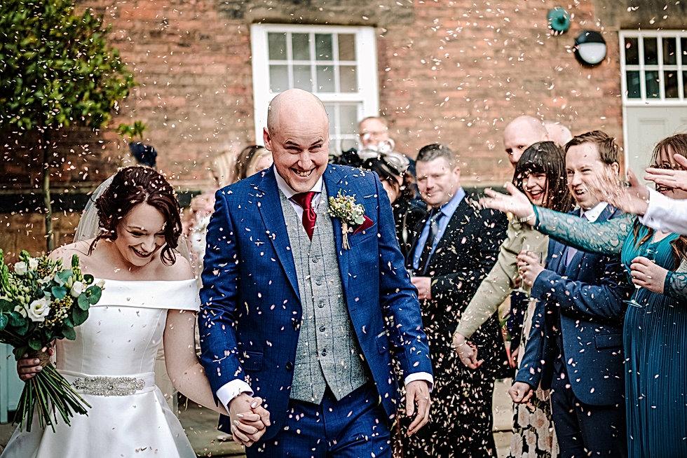 Wedding Photographer Birmingham, Bride & groom confetti photograph, fun informal photograph at The West Mill Derby