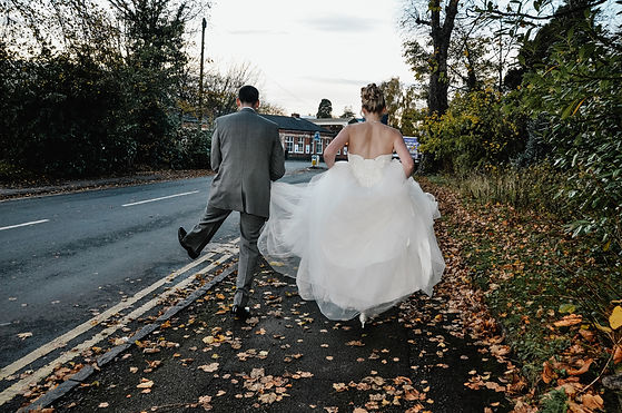 Wedding Photography Solihull, the bride & groom from behind, fun wedding photograph