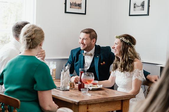 WEdding Photographer Birmingham, natural wedding photography, bride & groom sharing a joke with their guests, pub wedding