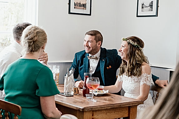 WEdding Photographer Birmingham, natural wedding photography, bride & groom sharing a joke with their guests, pub wedding