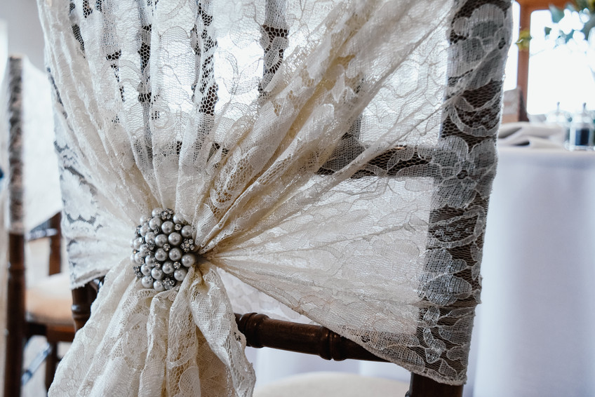 Solihull Wedding Photographer, close up detail of the seat coverings, rustic venue Wootton Park Warwickshire