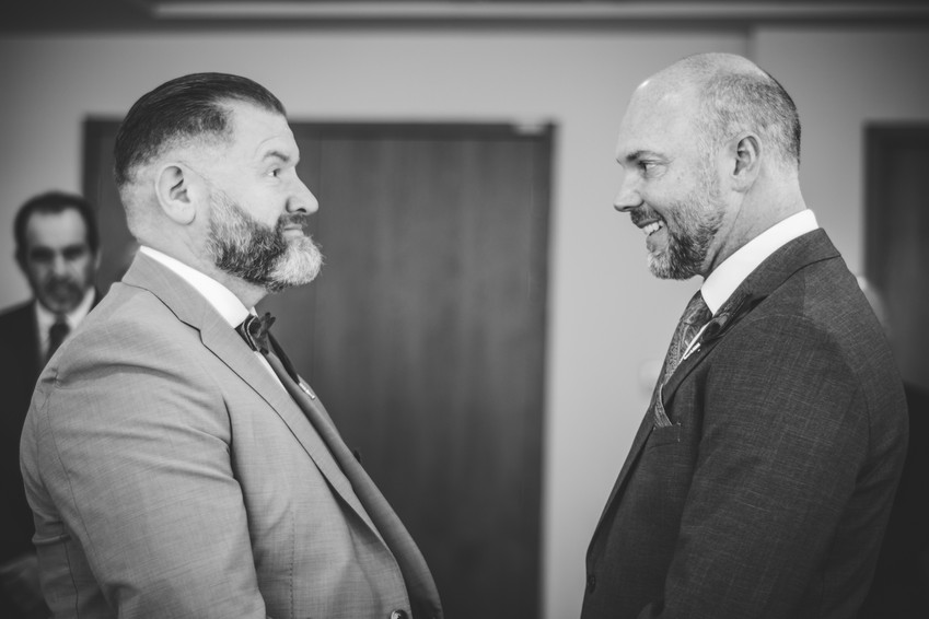 Birmingham Register Office Wedding Photographer Birmingham, fun photograph of the grooms looking at each other during the ceremony, black & white image