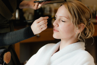 Wedding Photographer Solihull, bride having her make up done before her wedding at Westmead hotel Birmingham