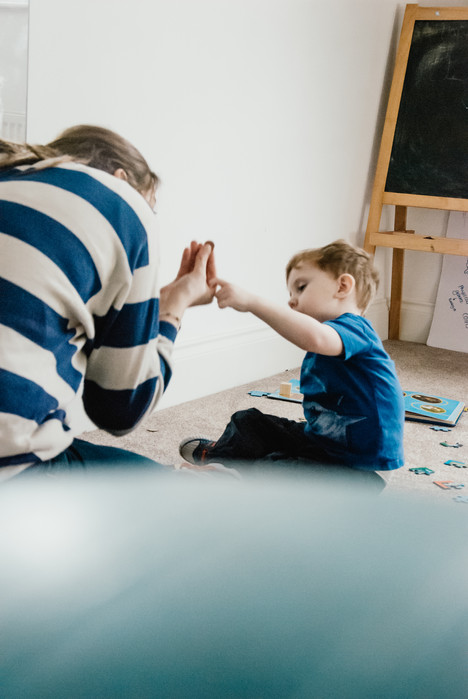 Natural Family Photographer BirminghamPhoto story of a boy with autism, playing with his carer