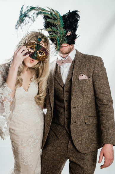 Wedding Photographer Solihull, photobooth photograph of the bride & groom in masks, fun happy image at Wootton Park Warwickshire
