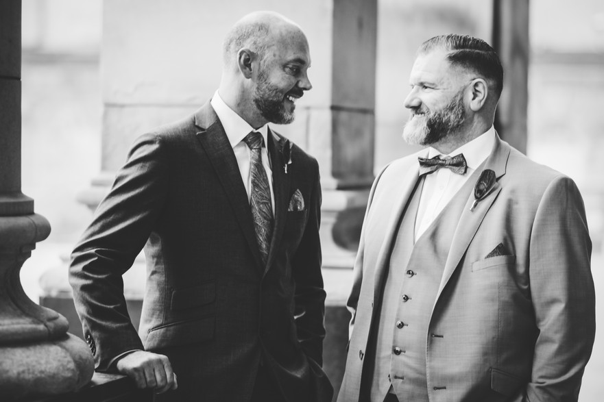 Civil Wedding Wedding Photographer Birmingham, the grooms looking at each other, black & white photograph, smiling informal photograph