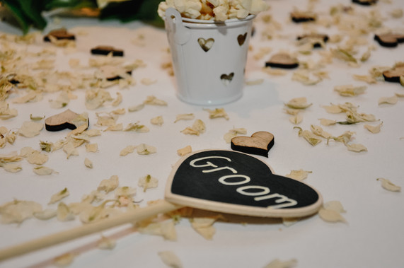 The Limes Wedding Photographer Solihull, Wedding Photographer Birmingham, close up of a place name with groom written on it in the shape of a heart
