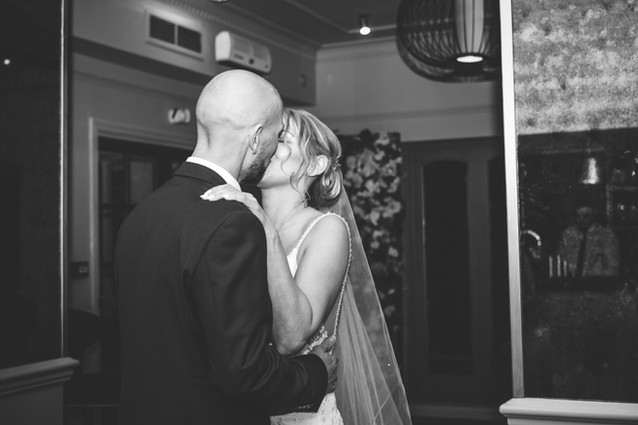 Wedding Photographer Birmingham, bride & groom kissing at the Westmead hotel Birmingham