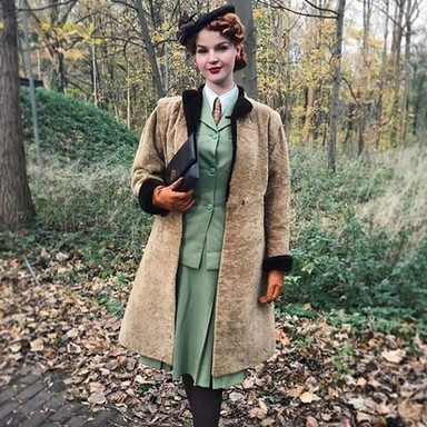 vintage lady in autumn leaves.jpg
