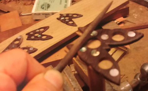 Detailed pearl dot inlay work