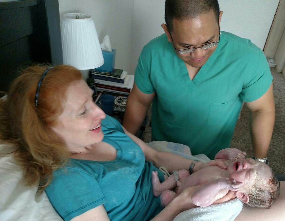 newborn in mom's arms doula care