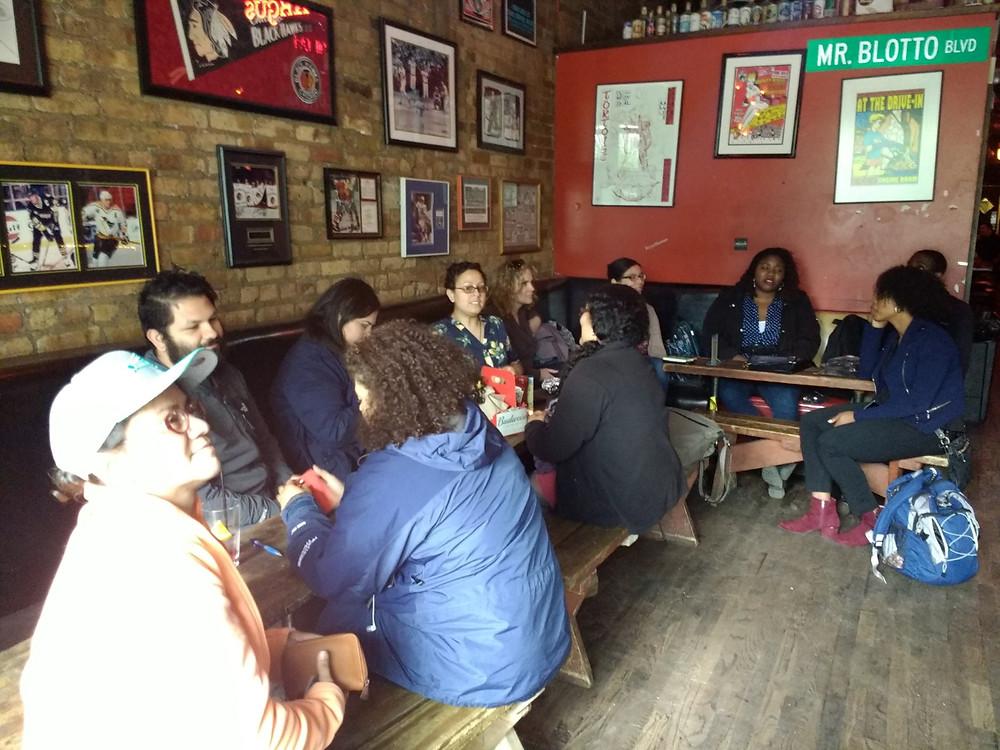 people sitting at Reggies talking