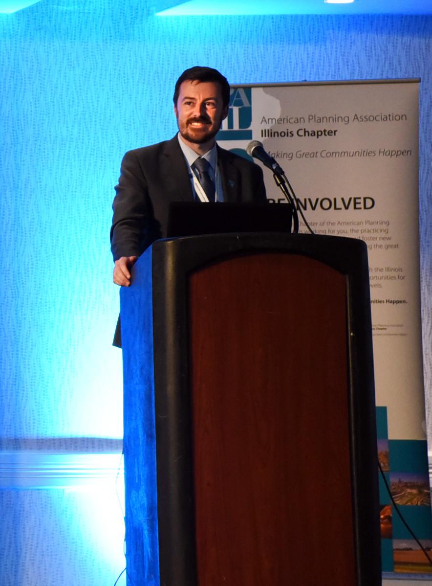 TJ Blakeman standing at podium at 2018 APA-IL State Conference