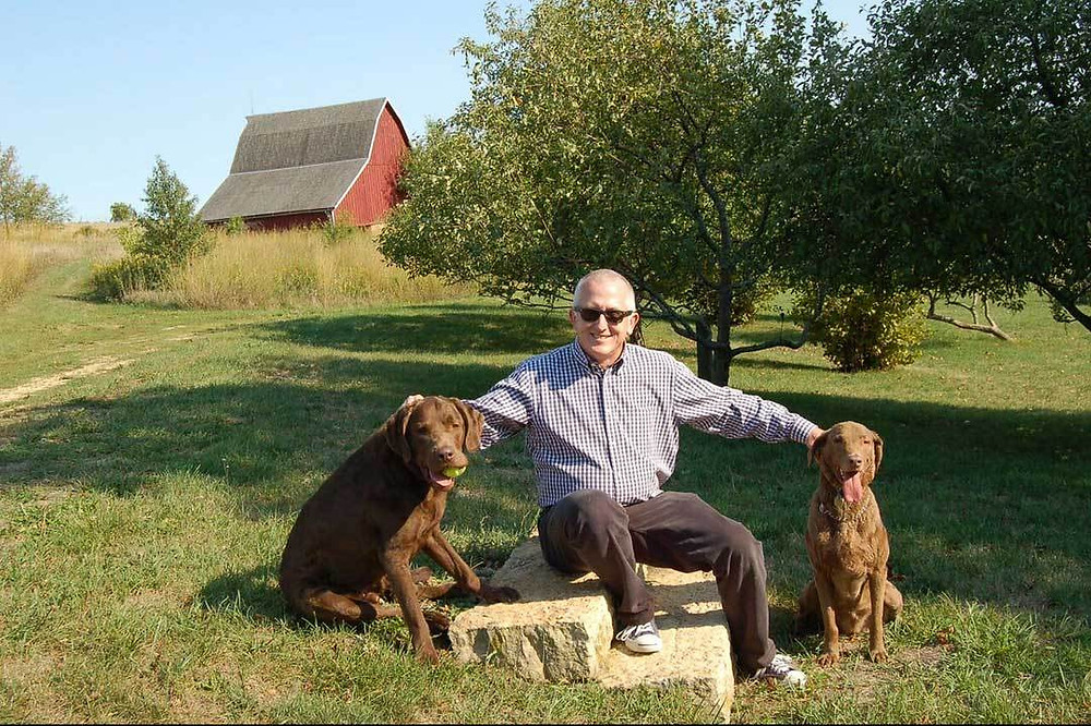 TJ Callahan on Brown Dog Farm with his dogs