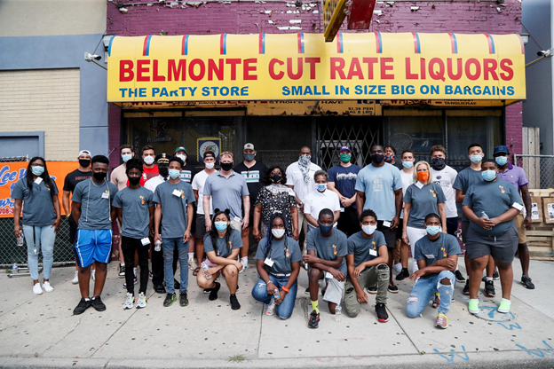 Group standing in front of storefront