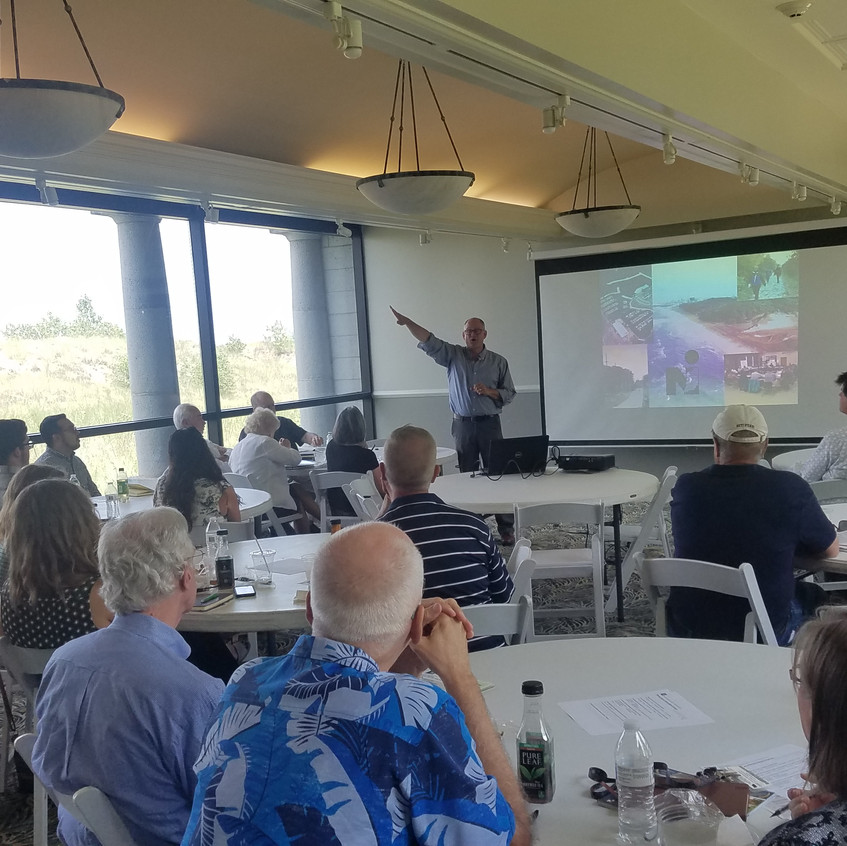"""Ty Warner, Executive Director, NIRPC, kicking things off at the Marquette Park Aquatorium in Gary, IN. The APA-CMS Program """"Planning Issues of Illinois-Indiana"""" was held on 7/11/18.(photo by Brandon Nolin, AICP)"""