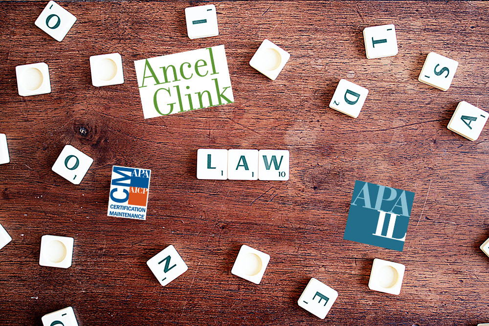 scrabble pieces scattered on a wood table with APA-IL, Ancel Glink, and AICP CM logos