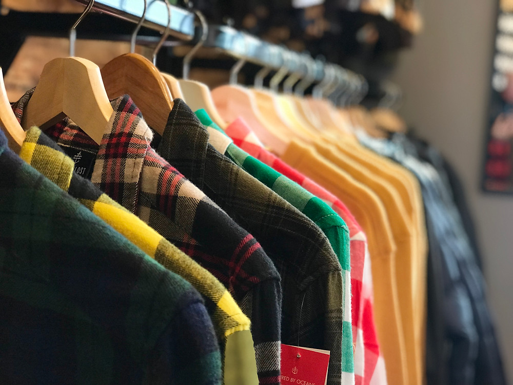 a view of flannel shirts at the shop