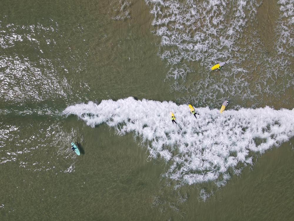 drone view of a surf lesson in peniche