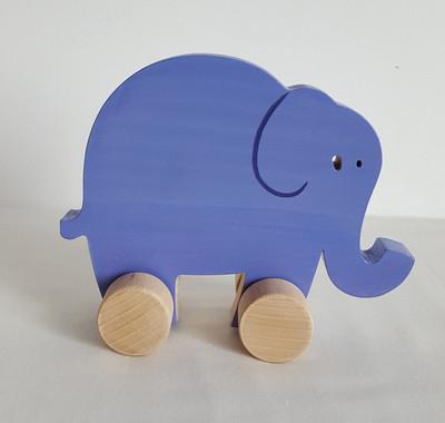 Jouet en bois : éléphant à pousser. Petit jouet à roulettes violet fabriqué en france et à la main. Bois français, peintures et vernis du Jura. Personnalisation possible.