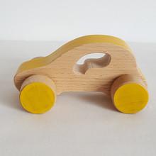 Jouet en bois : voiture Citadine jaune. Dans cette collection de véhicules en bois, 5 modèles : la voiture de course, la berline, la citadine, le camion et l'ambulance.  Ce sont de grandes voitures pour petites mains, entièrement faites en bois. Alors en route !    En bois de hêtre ou tilleul  Conseillé à partirde 1 an  Les dimensions varient en fonction des modèles.  Exemplede dimensions - Voiture de course : 14.5 x 4.5 cm  - Berline : 12 x 6 cm- Camion: 13.5 x 7.5 cm    Si le modèle souhaité n'est pas en stock, vous pouvez le commander, choisir la couleur et le faire personnaliser avec l'ajout d'un prénom.    Conforme aux normes européennes EN71-1 et EN71-3.Jouet fabriqué et peint à la main en France.