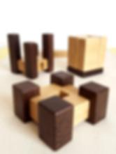 """Objet deco fabriqué en france. Porte-bougies au design original. 3 styles pour ces objets déco en chêne et wengé.      Dimensions - """" Le carré """" ( 10 cm x 10 cm x 5 cm), photo #1  - """" L'abstrait """" ( 8 cm x 8 cm x 7 à 10 cm), photo #2 - """" Le cubique """" ( 7 cm x 7 cm x 9.5 cm), photo #3    Bougeoir vendu à l'unité, grande bougie comprise. Les longues bougies carrées sont réalisées par un artisan cirier """"V.O. Bougies"""". Longueur : 25 cm.      Tous les objets déco sont fabriqués avec des matériaux sains et français (bois et vernis)."""