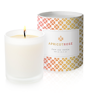 Apricot candle with lit candle