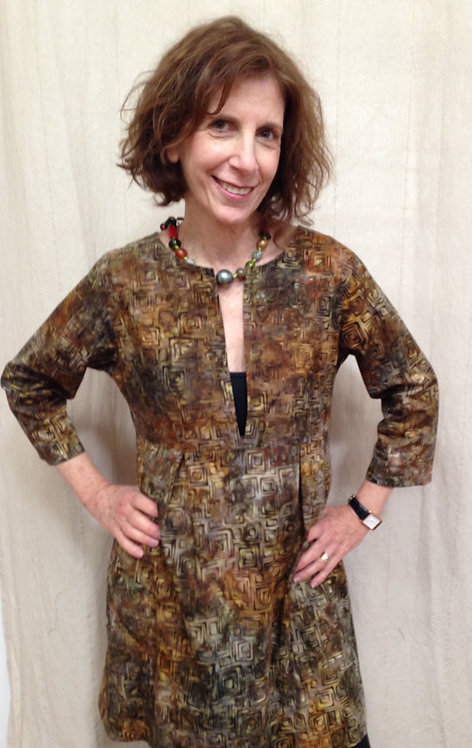 Illuminated gold and brown tunic