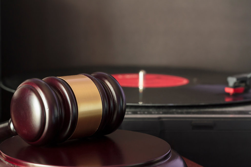 Judge's gavel and vinyl record player. Concept of entertainment lawsuit, music piracy and
