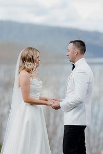 bride and groom at alter at The Black Barn, Lake Tarawera