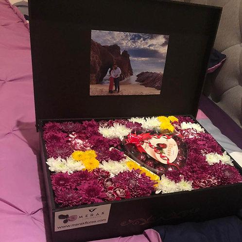 Caja de flores y dulces