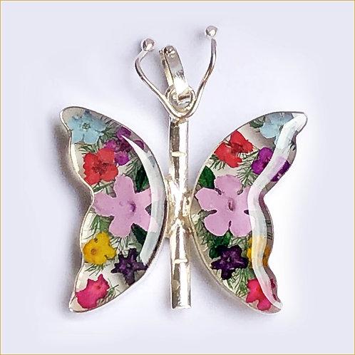 Dije en forma de mariposa