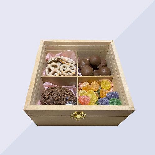 Caja con chocolates y gomitas