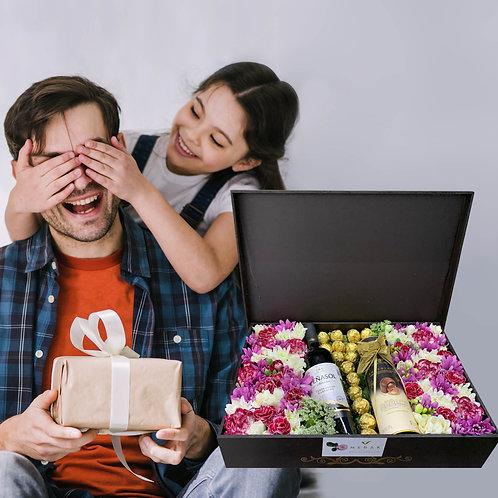 Caja de flores, vino y chocolates