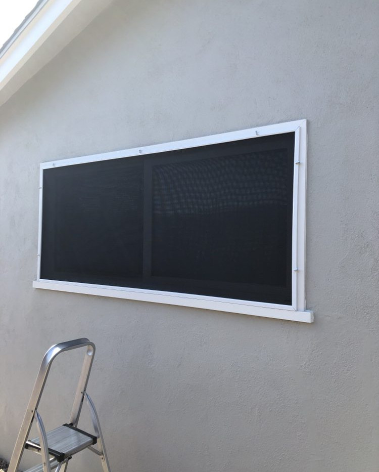 Custom window screen using Suntek solar screen to protect artificial grass. Also used for added privacy and heat reduction/protection.