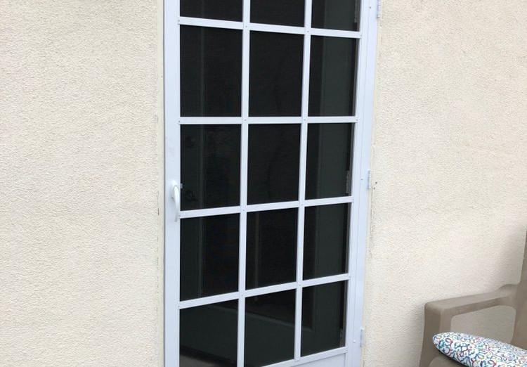 Custom swinging door installation. Door style is Cape Code.